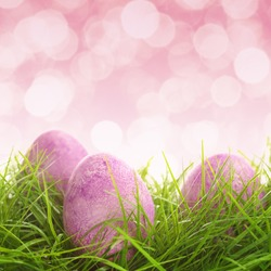 Easter eggs on the grass isolated on white background