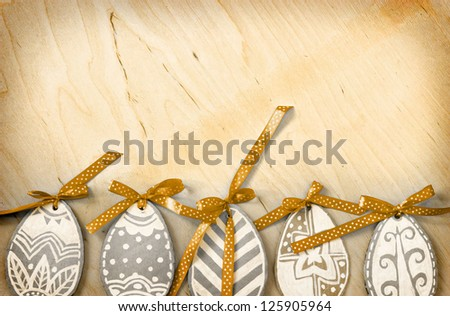Easter eggs on wooden background/ vintage Easter card with  eggs
