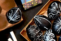Easter eggs painted with chalk paint. Painted black easter egg.