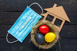 easter eggs red, yellow and black as german or belgium flag colors. Happy Easter holiday  nest card