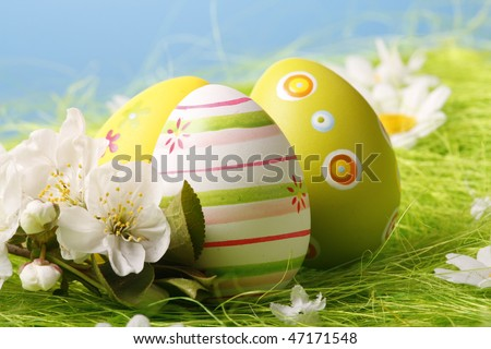 Easter Eggs sitting on grass field with blue sky
