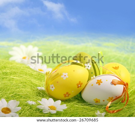 Easter Eggs sitting on grass field with blue sky background