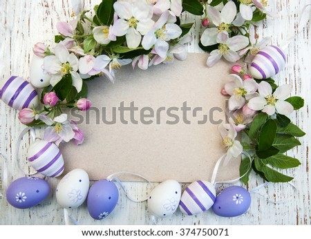 Easter eggs, spring apple blossom and greeting card