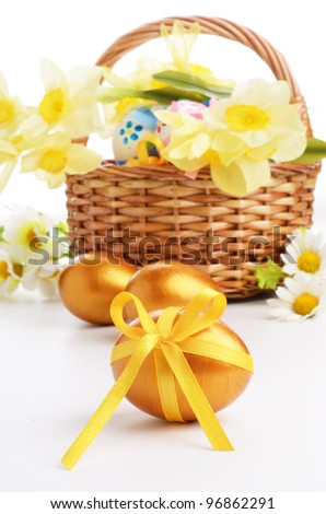 Easter eggs with bows over white background