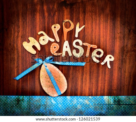 "Easter eggs with lettering ""happy easter"" on textured background/ vintage Easter card with  eggs"