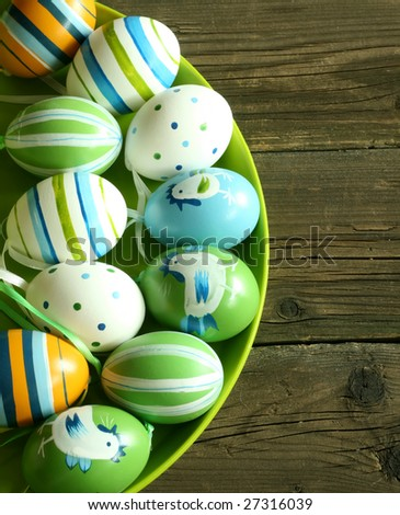 Easter eggs with ornament on wooden