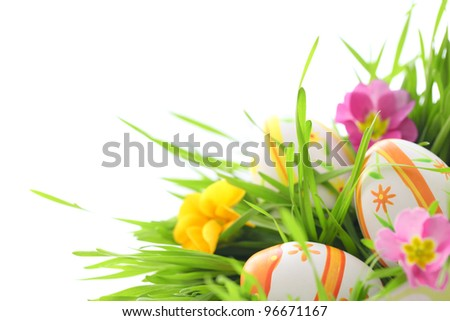 easter eggs with primrose in grass - stock photo