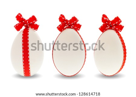 easter eggs with red ribbon bow isolated on white background