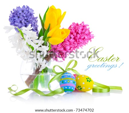 easter eggs with spring flowers isolated on white background