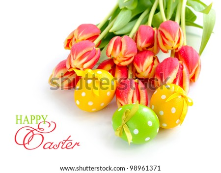 Easter eggs with tulips on white background #98961371