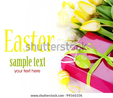easter eggs with yellow tulip flowers and gift box  isolated on white background(with sample text)