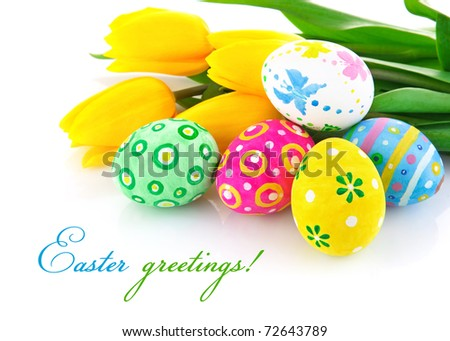 easter eggs with yellow tulip flowers isolated on white background