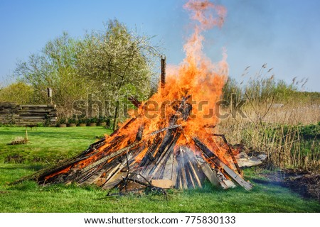 Easter fire on a meadow in spring time.