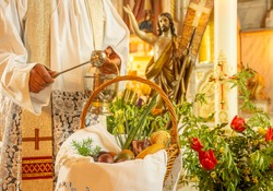 Easter food basket for blessing in church, catholic eastern european custom with eggs, spring onion, ham and bread