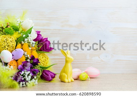 Easter greeting card of fresh flowers with eggs, happy easter, copy space #620898590
