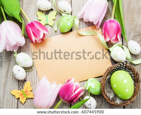 Easter greeting card on a old wooden background #607445900