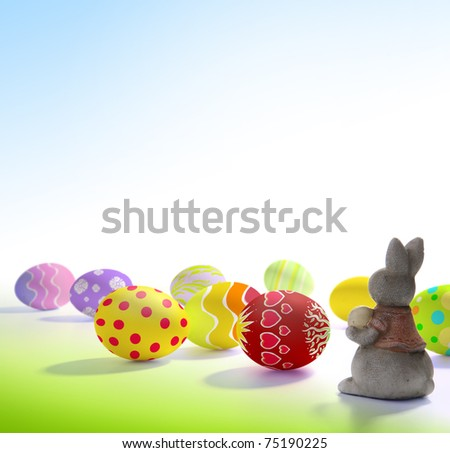 Easter greeting card with colored eggs and Easter bunny