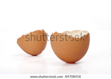 Easter greeting theme with broken egg and copyspace for your text over white background