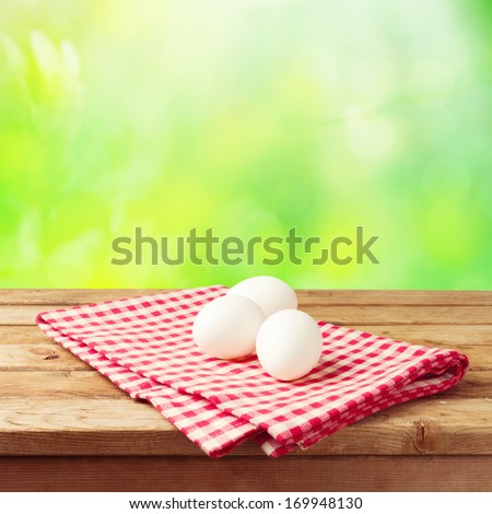 Easter holiday background with eggs on tablecloth