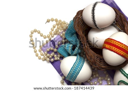 Easter holiday. Easter eggs with colored ribbon. Photo.