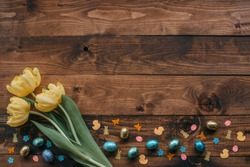 Easter holliday background with tulips on a wooden board, Place for text