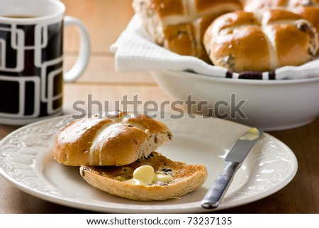 Easter Hot Cross Buns.Traditional spiced, sticky glazed fruit buns with pastry crosses toasted with lashings of melted butter and a large mug of tea.