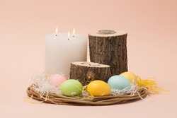 easter interior composition with painted eggs and candles in a natural style. Easter card.