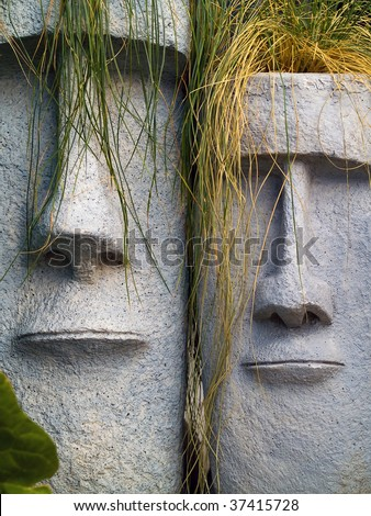 Easter Island planters with long green and yellow grass hair