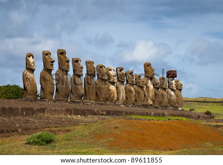 Easter Island statues in line under the blue sky