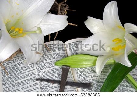 easter lilies and nails on open holy bible