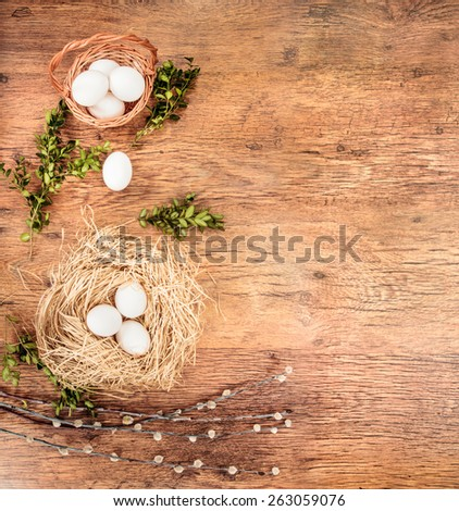 Easter natural composition  on a wooden table with space for text