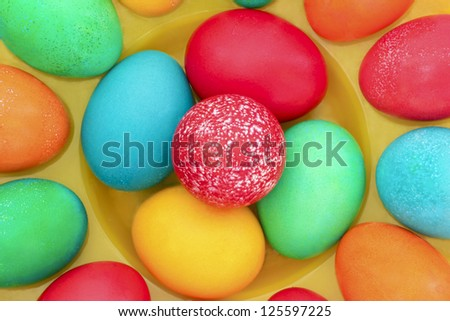 Easter painted with eggs on the yellow stand.