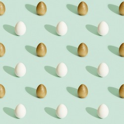 Easter pattern with bright eggs, shiny golden colored and white eggs on green paper background. Easter print.