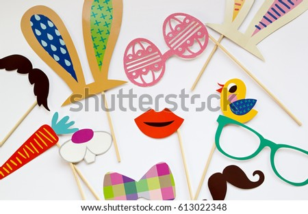 Easter photo booth props scattered on a white background