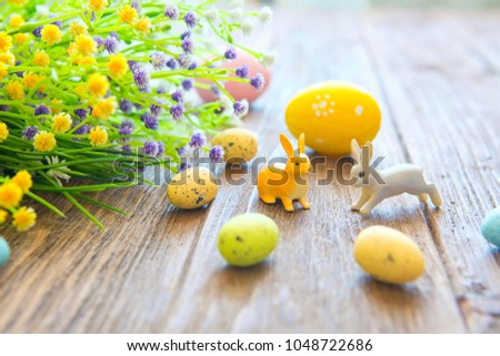 Easter rabbit with Easter eggs on wooden background. Close-up. #1048722686