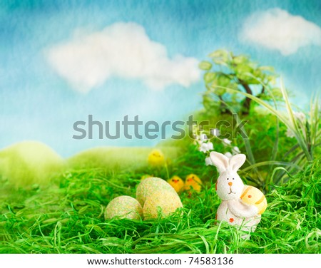Easter scene with chicks and bunny in the spring meadow. - stock photo
