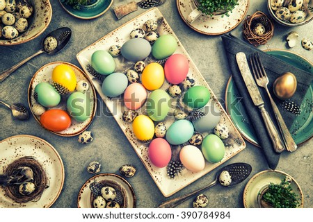 Easter still life with colored eggs. Vintage style toned photo