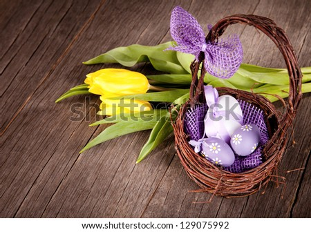 Easter still life with eggs in basket