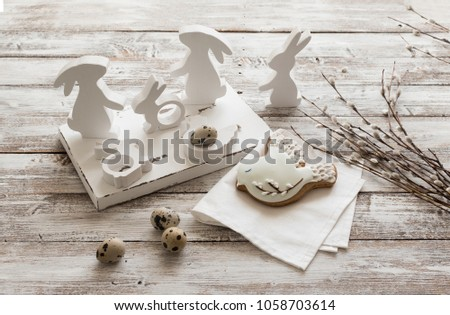 Easter still life with hares and eggs #1058703614
