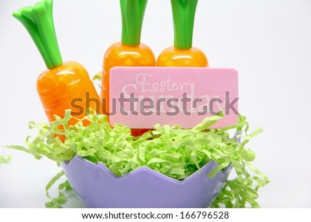 Easter Sunday Carrots Purple bowl with carrots and a \'Easter Sunday\' sign.