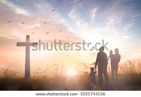 Easter Sunday concept: Silhouette family looking for the cross of Jesus Christ on autumn sunrise background #1035743536