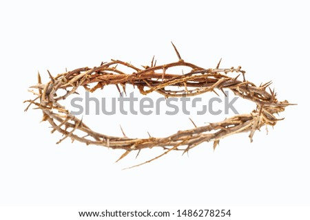 Easter symbolism, the crucifixion and resurrection of the son of god and the passion of Jesus Christ conceptual idea with crown of thorns isolated on white background with clipping path cutout #1486278254