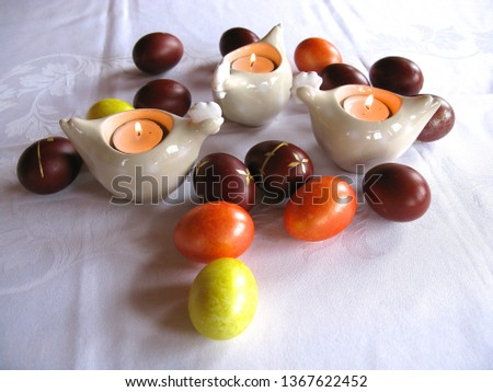 Easter symbols - Ester cake and eggs with oak grass and porcelain  figures of chicken. #1367622452
