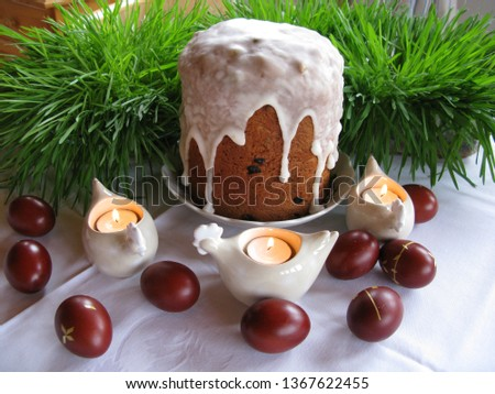 Easter symbols - Ester cake and eggs with oak grass and porcelain  figures of chicken. #1367622455