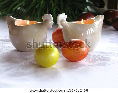 Easter symbols - Ester cake and eggs with oak grass and porcelain  figures of chicken. #1367622458