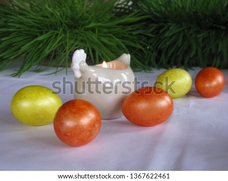 Easter symbols - Ester cake and eggs with oak grass and porcelain  figures of chicken. #1367622461