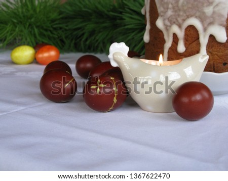Easter symbols - Ester cake and eggs with oak grass and porcelain  figures of chicken. #1367622470