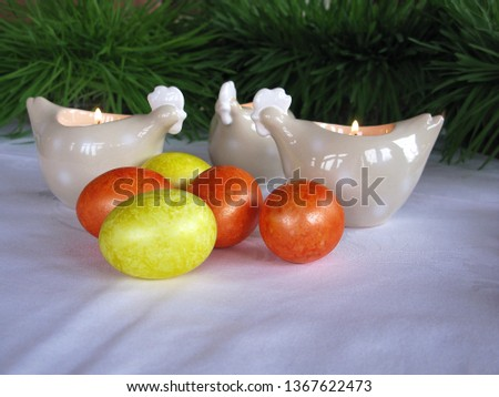 Easter symbols - Ester cake and eggs with oak grass and porcelain  figures of chicken. #1367622473