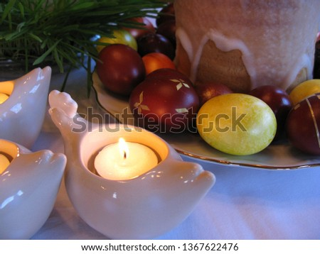 Easter symbols - Ester cake and eggs with oak grass and porcelain  figures of chicken. #1367622476