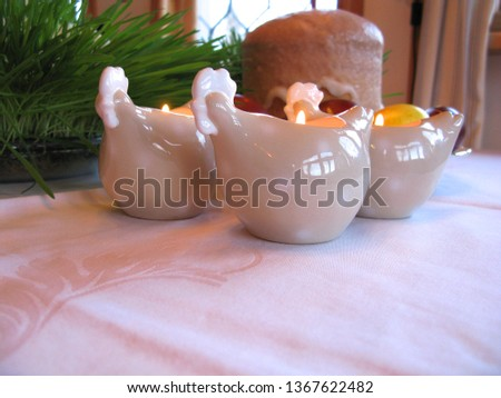 Easter symbols - Ester cake and eggs with oak grass and porcelain  figures of chicken. #1367622482